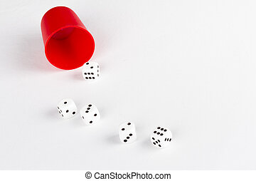 Tumbler and five dice
