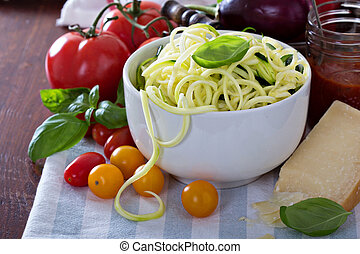 Zucchini noodles in a bowl with fresh vegetables and cheese