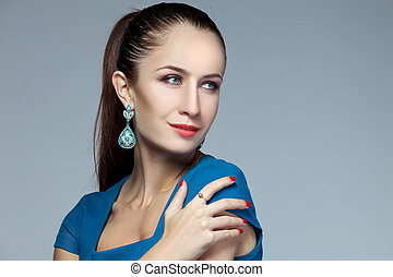 Portrait of beautiful fashion model posing in exclusive...