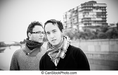 Gay couple - Loving gay couple in outsite. Photographs in...