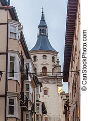Tower of old cathedral in the old town in Vitoria, Basque...