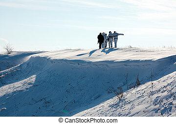 Hunters walking in snow