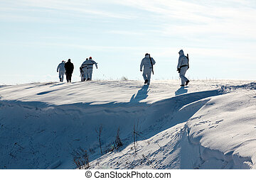 Hunters walking in snow - Group of hunters walking on the...