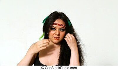 young face with hippie art make up - beautiful young woman...