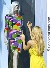 blonde near a show-window - a blonde in yellow dress near...