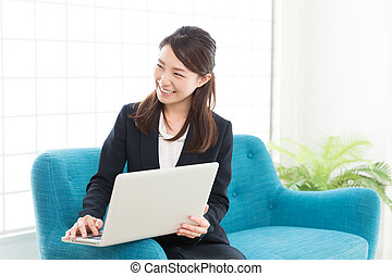 woman who waits on customers - young attractive asian woman...
