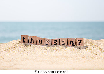 Thursday word on sand and seaside - Thursday word on wood...