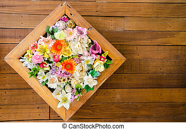 colorful flower on wooden background