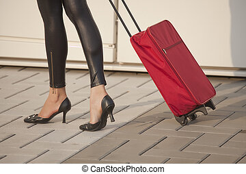 woman with luggage - woman pulling her luggage on the street