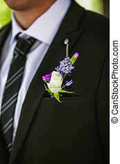 boutonniere - Close-up of groom's boutonniere with white...