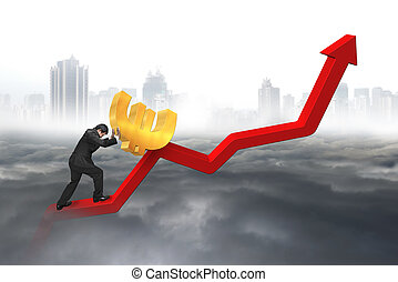 businessman pushing euro at trend chart starting point with...