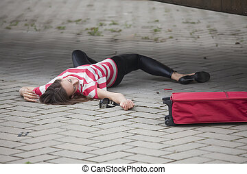 crime scene on the street - unconscious woman lying on...