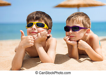 Two children on the beach - Portrait of two children on the...