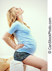 childbearing - Beautiful pregnant woman relaxing on the...