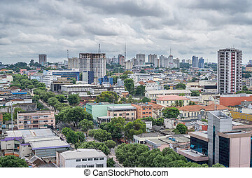 Colorful houses, cloudy sky in Manaus, Brazil - Wide view of...