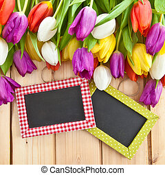 Colorful tulips in springtime on rustic wooden boards
