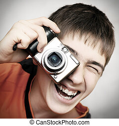 Teenager with Photocamera - Toned Photo of Teenager with...
