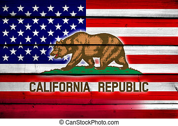 USA and California State Flag on wood background