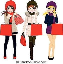 Winter Women Shopping - Three beautiful young women in...