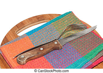 Old kitchen knife and fork on the board