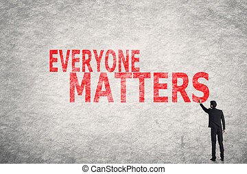 text on wall, Everyone Matters - Asian businessman write...