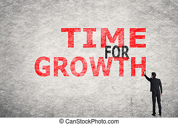 Time For Growth - Asian businessman write text on wall, Time...