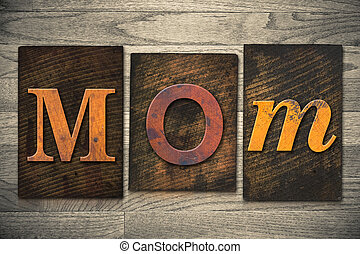 Mom Concept Wooden Letterpress Type - The word MOM written...