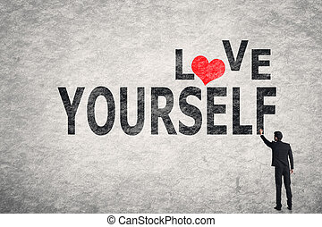 Love Yourself - Asian businessman write text on wall, Love...
