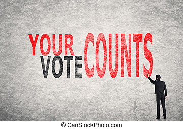 Your Vote Counts - Asian businessman write text on wall,...