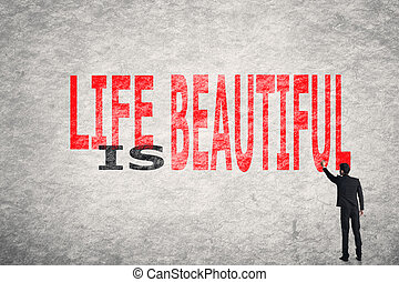 Life is Beautiful - Asian businessman write text on wall,...