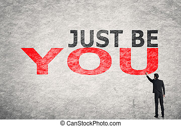 Just Be You - Asian businessman write text on wall, Just Be...