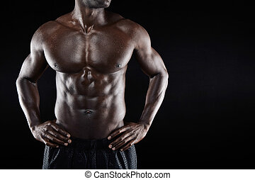 Torso of a muscular man with copyspace - Cropped image of...