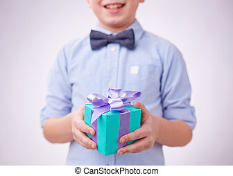 Gift for a parent - Close-up of gift box on hands of a boy