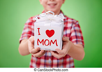 Gift for mom?s birthday - Little boy showing gift for mother...