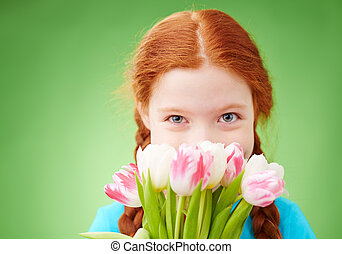 Shy girl - Close-up of a girl smelling bunch of tulips