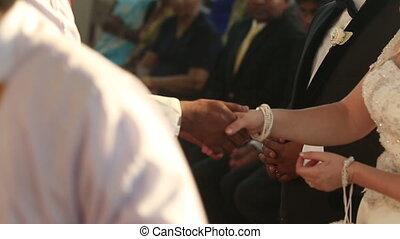 indian groom and european bride - priest shake european...
