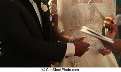 indian groom and caucasian bride - Catholic priest is...
