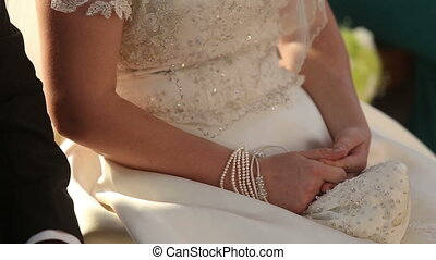groom sit next to bride on wedding in catholic church and...