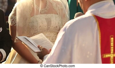indian groom and caucasian bride - Catholic priest read...
