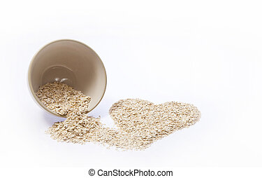 Rolled Oats Heart - Rolled oats pouring out of a bowl into a...