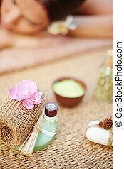 Beauty treatment - Cosmetic objects with relaxed female on...