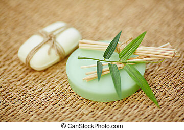 Soap and sticks - Toilet soap and wooden cosmetic sticks on...