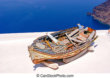Old traditional boat on terrace, Santorini island, Greece