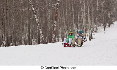 Sledge Fun for Adults - Girl and guy holding hands sledding...