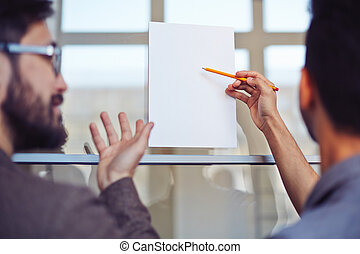 Pointing at blank paper