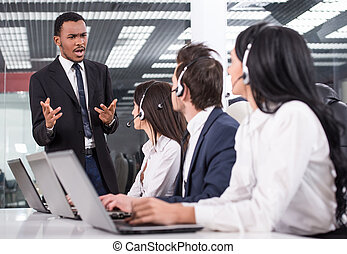 Call center - Manager is explaining something to employees...