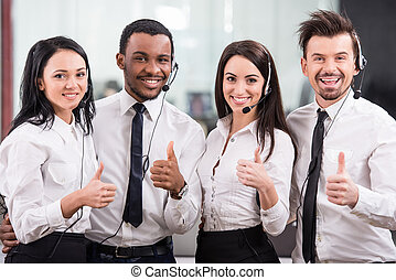 Call center - Group of happy, cheerful call center workers...