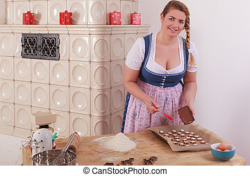 Young woman covering Cookies with c - Young blond, fat girl...