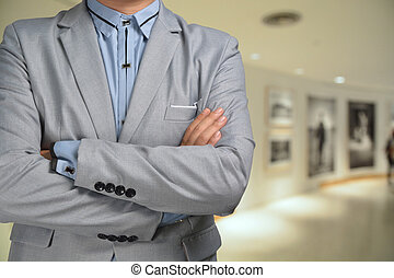 Photographer in Suit standing in front of Blur Background of...