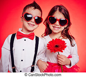 Sunny kids - Portrait of a funny couple in heart-shaped...